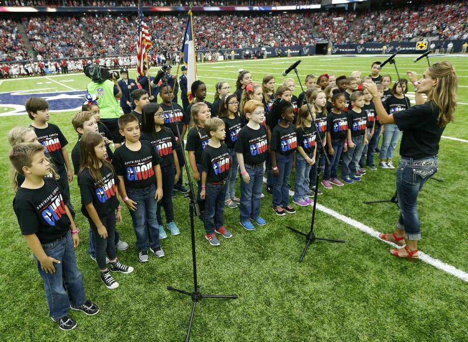 The Northland Christian School elementary choir, led by director Tamara Nelson, performs the national anthem before an NFL preseason football game between the Arizona Cardinals and the Houston Texans at NRG Stadium Sunday, Aug. 28, in Houston. Photo: Brett Coomer