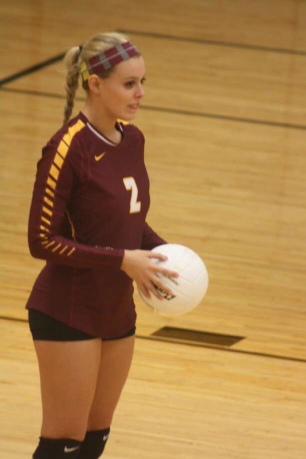 Caitlyn Campo prepares for an extended stay at the serving line as she gets ready to start Game 2. Campo held serve for the opening seven points, one of numerous runs Deer Park enjoyed in blasting Sam Rayburn 3-0. Photo: Robert Avery