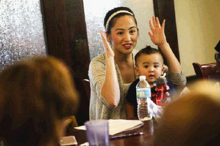 Keleigh Dao introduces herself during the AutismShare group meeting on Tuesday. This was Dao's first meeting after learning her three-year-old son has autism. Photo: Michael Minasi