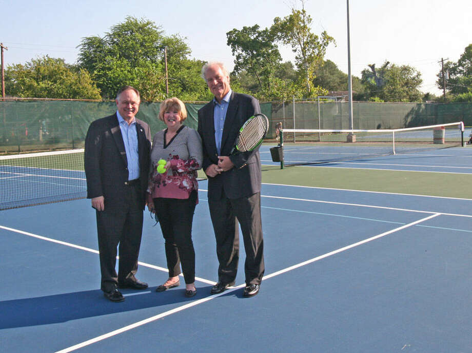 "HTA President Ted Erck, Executive Director Cheryl Hultquist Horvath and Houston Council Member Mike Laster District J) admire the resurfaced courts at Lee LeClear.  ""I am grateful to the Houston Tennis Association for donating this money to resurface the courts at the Lee LeClear Tennis Center.  HTA's donation goes hand in hand with many exciting new improvements coming to the tennis center.  I know that all those who frequent this public facility are greatly appreciative,"" Laster remarked."