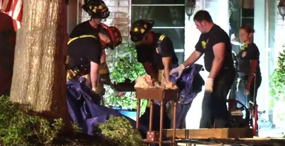 A family scrambled to safety but their dog did not make it out as fire swept through their house about 7:45 p.m. Tuesday, Sept. 13, 2016, in the 21600 block of Park Downe Lane near Park Wind Drive in west Harris County. Photo: Metro Video