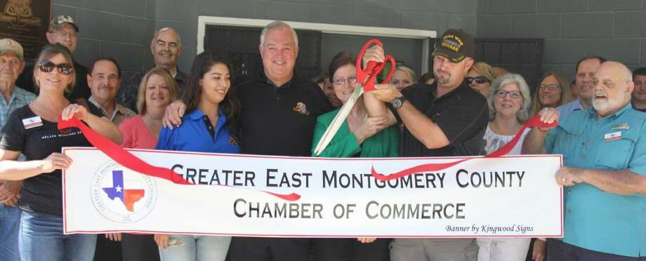Jack Wieghat cuts the ribbon to commemorate Trinity Armory joining the Greater East Montgomery Chamber of Commerce on Sept. 14. Trinity Armory is located on CR 388 in Cleveland, Texas. Photo: Jacob McAdams