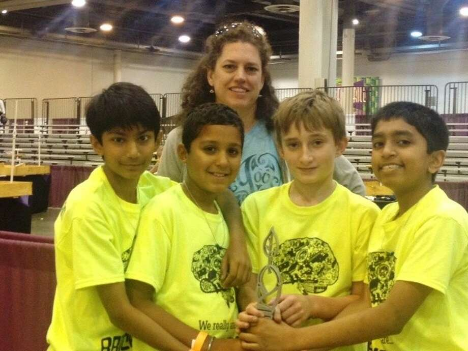 Posing for a picture are BrickSmart team members Rohan Zakharia, Kabir Jolly, Ben Huey, Thejas Davalath and Coach Katie Kelley.