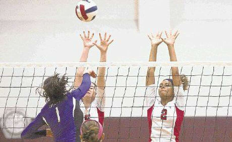 Atascocita's Taylor Smith and Shannon Faulkner go up to block a shot during a game at the Magnolia Volley Battle at Magnolia High School. Photo: Jason Fochtman