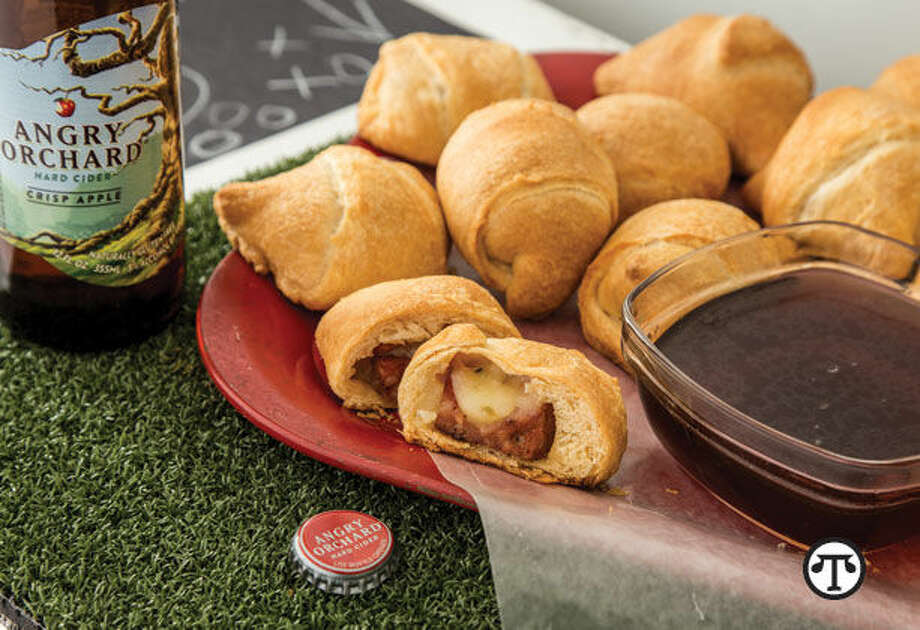 Pepper Jack Pigs in a Blanket with Angry Orchard Dipping Sauce pair well with cider-infused cocktails, great games and good times. (NAPS)