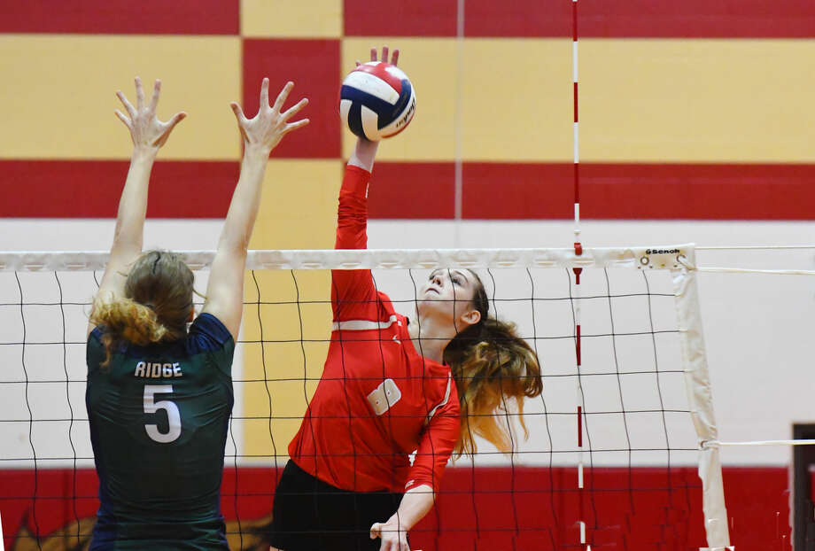 Cypress Woods outside hitter Paige Sebesta spikes a kill against Cy-Ridge Tuesday, Sept. 13, 2016 in a four-set victory against the Lady Rams. Sebesta, a Wake Forest commit, was the likely player of the game, with 26 kills and 13 digs. Photo: Tony Gaines