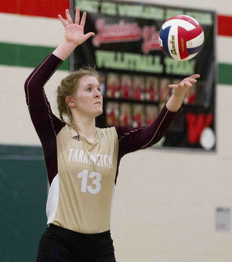 Tarkington's Claire Chapman (13) serves the ball during the third set of a non-district volleyball game Tuesday, Sept. 13, 2016, at The Woodlands High School. The Woodlands swept Tarkington 3-0. Go to HCNpics.com to view more photos from the game. Photo: Staff