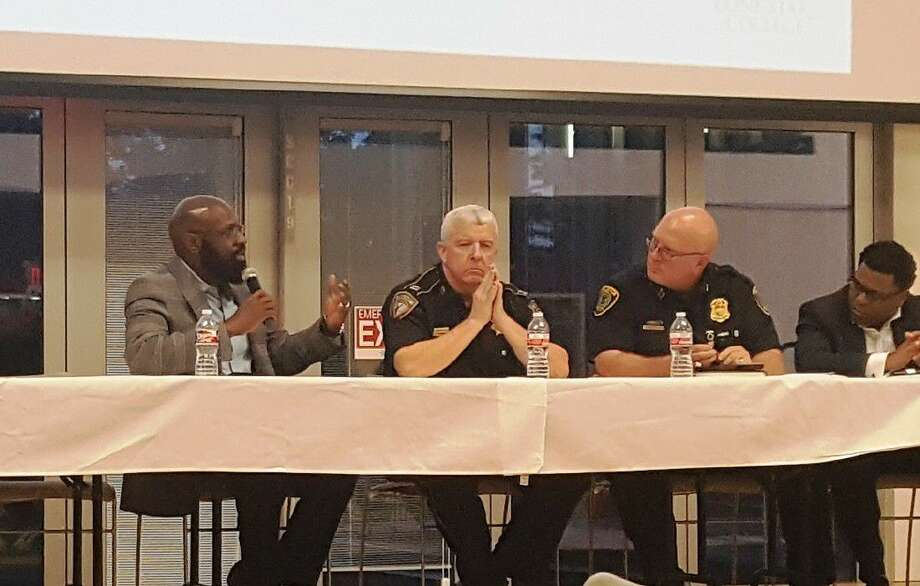 Pastor Shelton Bady of Harvest Time Church discusses the importance of the community and law enforcement expressing mutual respect of one another during the Community in Unity Panel at Lone Star College-Kingwood Monday, Sept. 12. From left to right: Pastor Shelton Bady, Captain Michael Richmond of Harris County Sheriff's Office, Captain Gregory Fremin with Houston Police Department Northeast, and Pastor E.A. Deckard with Green House International Church.