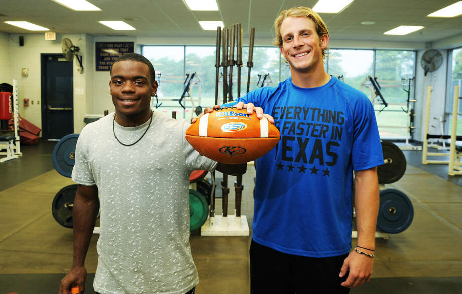 Klein Collins senior running back D'Anthony Doyle (left) and senior quarterback Bryson Powers (right) are the two primary weapons in the Tigers' juggernaut rushing attack. The two have combined for 107 rushes and 832 yards (nearly 7.8 yards per carry) so far through three games. Photo: Tony Gaines