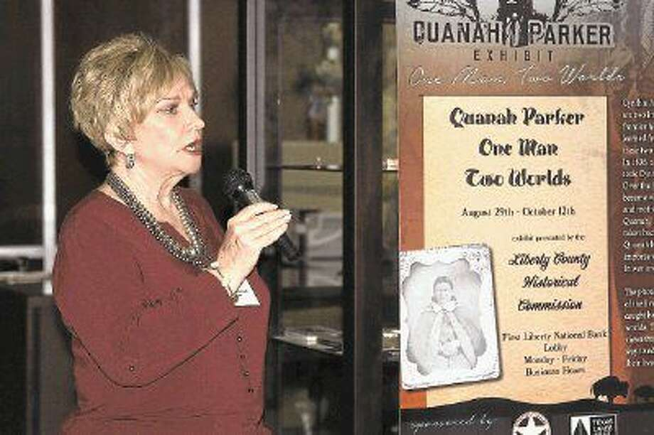 """Linda Jamison with the Liberty County Historical Society welcomes guests to a reception held on Sunday to mark the opening of the Quanah Parker Exhibit at First Liberty National Bank. Parker is remembered as the last Comanche chief. He died in 1911. The """"Quanah Parker Exhibit: One Man, Two Worlds"""" includes 45 rarely seen images of Quanah, his mother, Cynthia Ann Parker, the Comanche and others. Photo: Vanesa Brashier"""