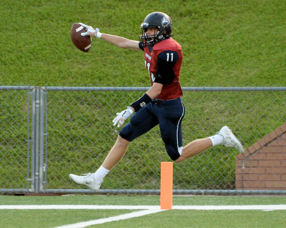 Parker Powell (11) of Tompkins scores after intercepting a pass thrown by the Bulldog's quarterback Jalen Green (3) in the second quarter of a high school football game between the Tompkins Falcons and Houston Heights Bulldogs on September 15, 2016 at Rhodes Stadium, Katy, TX. Photo: Craig Moseley