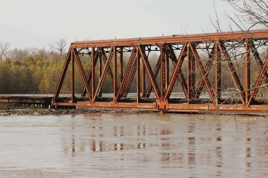 The trestles of the Union Pacific trestle bridge over the Trinity River in Liberty will be replaced Tuesday in a massive, 12-hour project. It is pictured during one of several flooding events in 2015, when the river was reaching flood stage. Photo: Vanesa Brashier