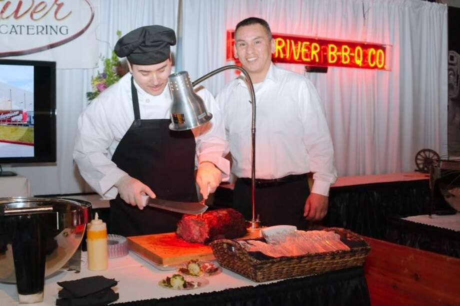 """A server carves a roasted prime rib for patrons at the Red River B-B-Q Co. booth during the Clear Lake Area Chamber of Commerce """"Taste of Space"""" Epicurean Evening Thursday, Feb. 6. Photo: KIRK SIDES"""
