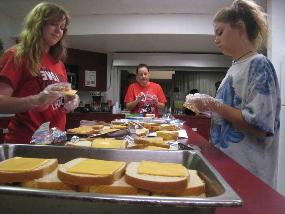 Every Wednesday, the Revolution's MISSION: SERVE youth group meets at the church to make the sandwiches and care packages for clients of the food bank.