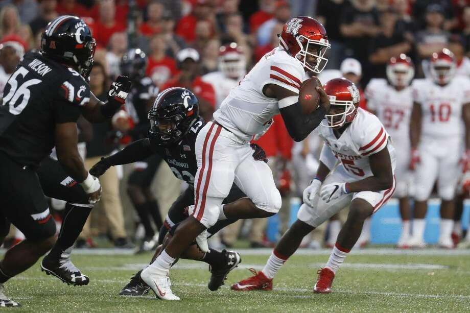 Houston quarterback Greg Ward Jr., center, runs the ball during the first half of an NCAA college football game against Cincinnati on Thursday.