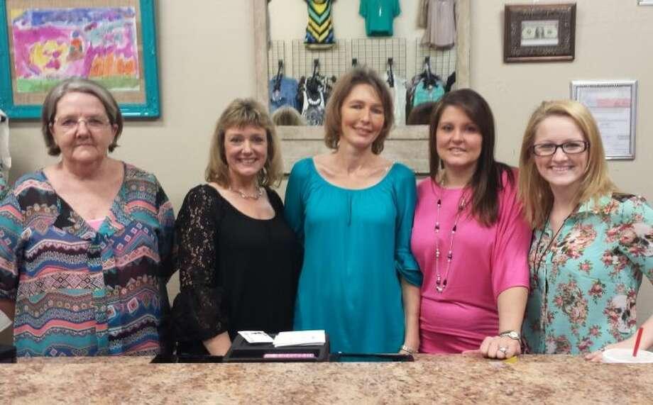 LoEva Bailey, Wendy Sweeten, Lee Bailey, Angela Coats and Cherin Bailey make up the staff at the newly opened women's apparel store Fem-A-tude. Photo: STEPHANIE BUCKNER