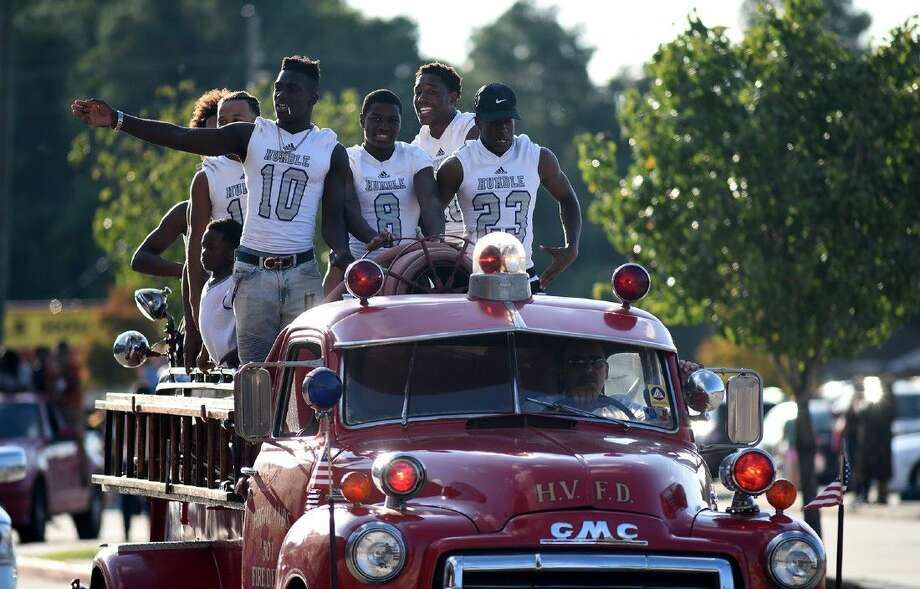 Humble High School varsity footballers Isaiah Robinson (10), a sophomore, and seniors Jayshun Anderson (8), Leron Bennett, and Daniel Murchinson ride on a 1949 GMC fire truck owned by former Humble Fire Marshall Clint Johnson and driven by current Humble City Fire Marshall James Nykaza during the HHS Homecoming Parade leading to the community pep rally held at Turner Stadium on Sept. 14, 2016. (Photo by Jerry Baker/Freelance) Photo: Jerry Baker