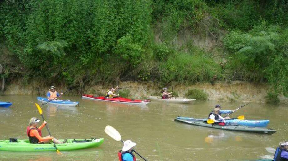 Paddlers race in a previous Cypress Creek Regatta event. Cypress Creek is now recognized as an official Texas paddle trail by Texas Parks and Wildlife.