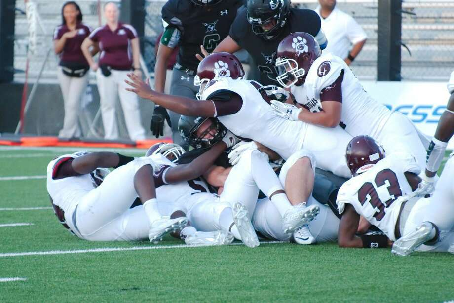 Kempner, pictured smothering a Clear Falls ball carrier in 2015, is 3-0 for the second consecutive season after victories against Mayde Creek, Nimitz and Hastings. The Cougars open District 20-6A play against Ridge Point. Photo: Kirk Sides