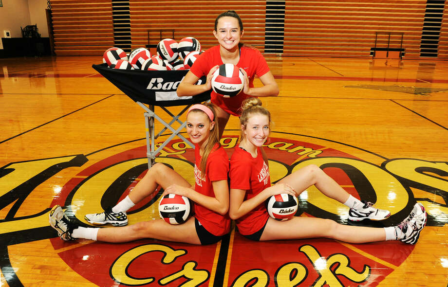 Langham Creek's three captains, from left to right: Ashley Lewis, senior outside hitter; Delaney Anderson, junior setter; Whitney Foreman, junior middle blocker. All three have been instrumental to the demeanor, character and work ethic of this Lobos team, says head coach Gena Rhodes. Photo: Tony Gaines