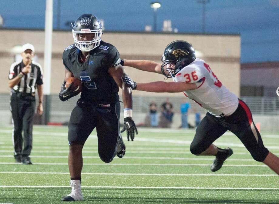 New Caney running back Marte Allison runs in for an 8-yard touchdown against Caney Creek at Texan Drive Stadium on Friday.