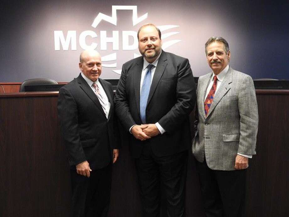 Montgomery County Public Health District Executive Director Randy Johnson (left) welcomes new MCPHD board members City of Conroe Councilman Duke Coon (center) and Panorama Village Mayor Lynn Scott (right) to the MCPHD board at the September meeting of the board.