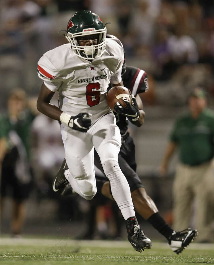 The Woodlands Highlanders Kesean Carter (6) catches a pass and gets away from George Ranch Longhorns Chima Amushie (32) and runs for a touchdown during the high school football game between The Woodlands Highlanders and the George Ranch Longhorns at Traylor Stadium in Rosenberg, TX on Friday, September 16, 2016. The Highlanders defeated the Longhorns 42-14. Photo: Tim Warner