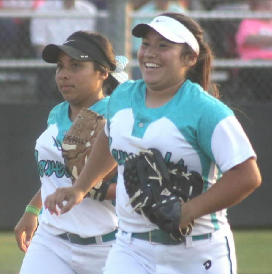 Missy Hernandez and Nika Garcia rejoice over the 5-3 twin-killing that ended Deer Park's first inning Friday night. Photo: Robert Avery