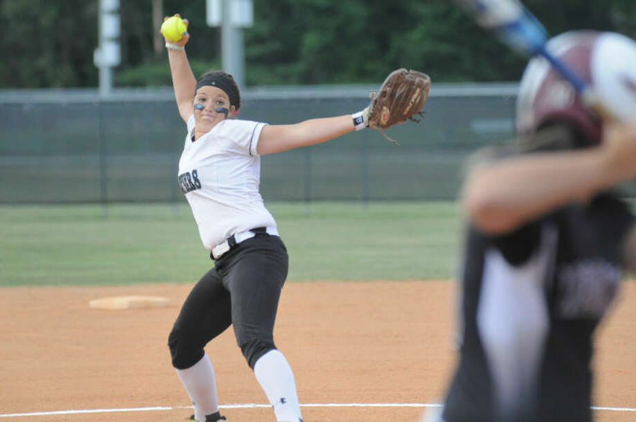 Kingwood Park's Jess Woods fires a pitch against Magnolia on Thursday. Photo: Keith MacPherson