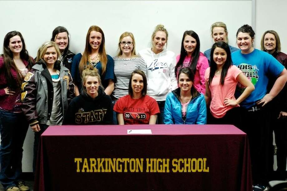 Kiley Allen has signed to play volleyball next year for the Trinity Valley Cardinals. A small celebration was held for her Wednesday, Feb. 5, at Tarkington High School. She posed here with the rest of the 2013-14 varsity team. Pictured (seated) with Kiley (center) are Erica Lott at left and Carley Coogler on right; (standing, from left to right) Victoria Bazzoon, Deborah Broyles, Ashley Holston, Anna Anderson, Hattie Lang, Madi O'Brien, Paige Montgomery, Sara Scott, Angela Welk, Karlee Wright and Coach Denise Johnson. Photo: CASEY STINNETT / Houston Community Newspapers, 2014