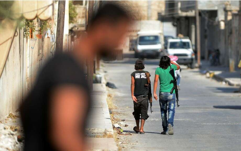 Free Syrian Army's young fighters patrol in Jarablus, Syria late last month.