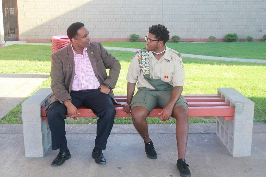Stafford High senior Frederick McCloud, who recently became an Eagle Scout, this week sits with Stafford MSD Superintendent Dr. Bostic, on the benches that he created as part of his Eagle Scout Project. Dr. Bostic is a fellow Eagle Scout who earned that honor in the 1980s. Photo: Submitted Photo