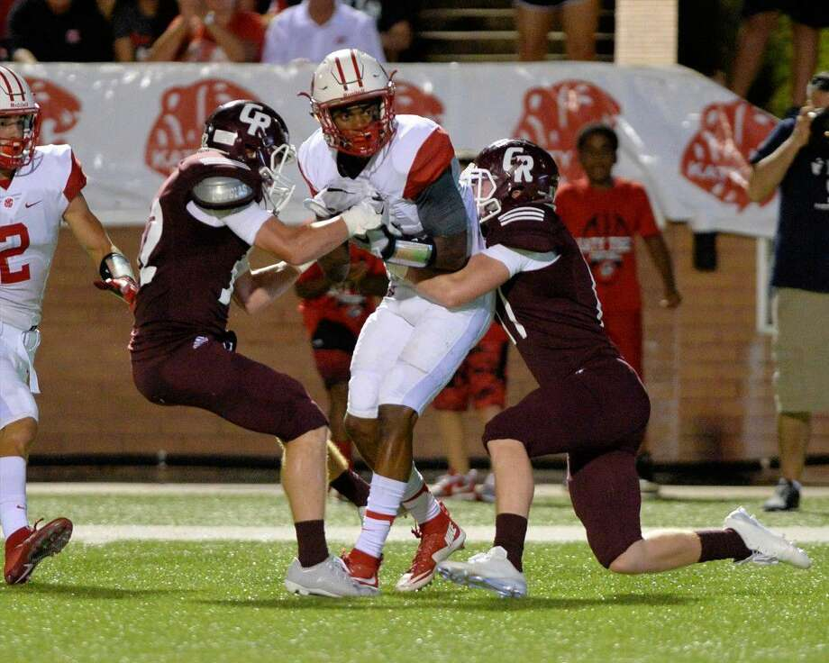 JC Angulo (18) of Katy scores the Tiger's second touchdown on second effort after catching a pass from quarterback (Rocky Emery (12) in the second quarter of a high school football game between the Cinco Ranch Cougars and Katy Tigers on September 16, 2016 at Rhodes Stadium, Katy, TX. Photo: Craig Moseley