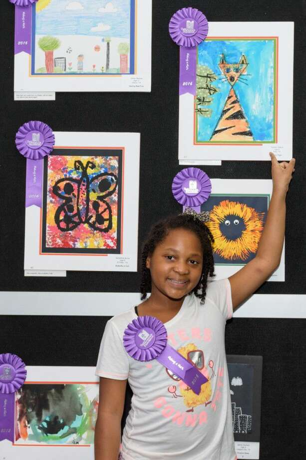 Tayden Ybarra, 8, of Katy stands in front of her artwork. On Sept. 10, The Periwinkle Foundation celebrated the opening of the 26th Annual Making A Mark, an exhibition of art and creative writing by children touched by cancer and blood disorders at Texas Children's Cancer and Hematology Centers. The Auxiliary Bridge on the third floor of the Clinical Care Center was adorned with more than 300 colorful works of art by patients and their siblings creating an inspirational display in honor of Childhood Cancer and Sickle Cell Disease Awareness Month. The art will be on display through Oct. 7 at Texas Children's Hospital before it goes on the road. Photo: Larry Geiger