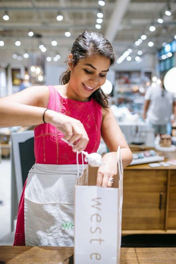 Carla Navarro, owner of Whisk Bakery, puts a customer order together. Photo: Becky Smith