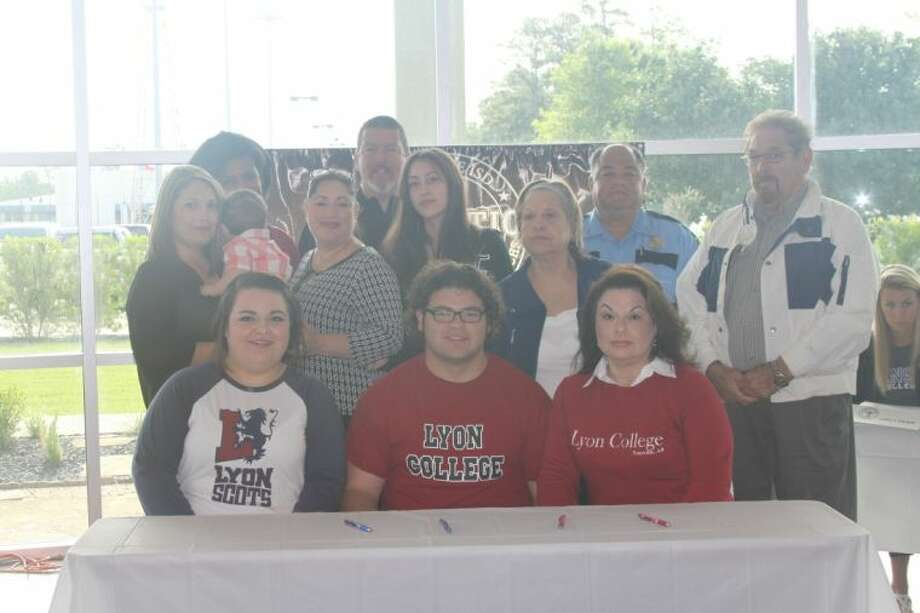 Austin Morales, front- center, signed with Lyon College in Arkansas last week at Humble ISD's signing ceremony.