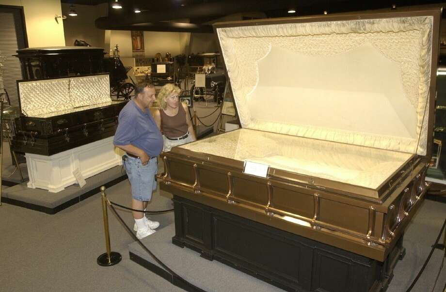 Pat and Betty Elko of Bettendorf, IA look at a casket built for three in the 1930's at the National Museum of Funeral History, 415 Barren Springs, Friday, July 23, 2004. Photo: Melissa Phillip
