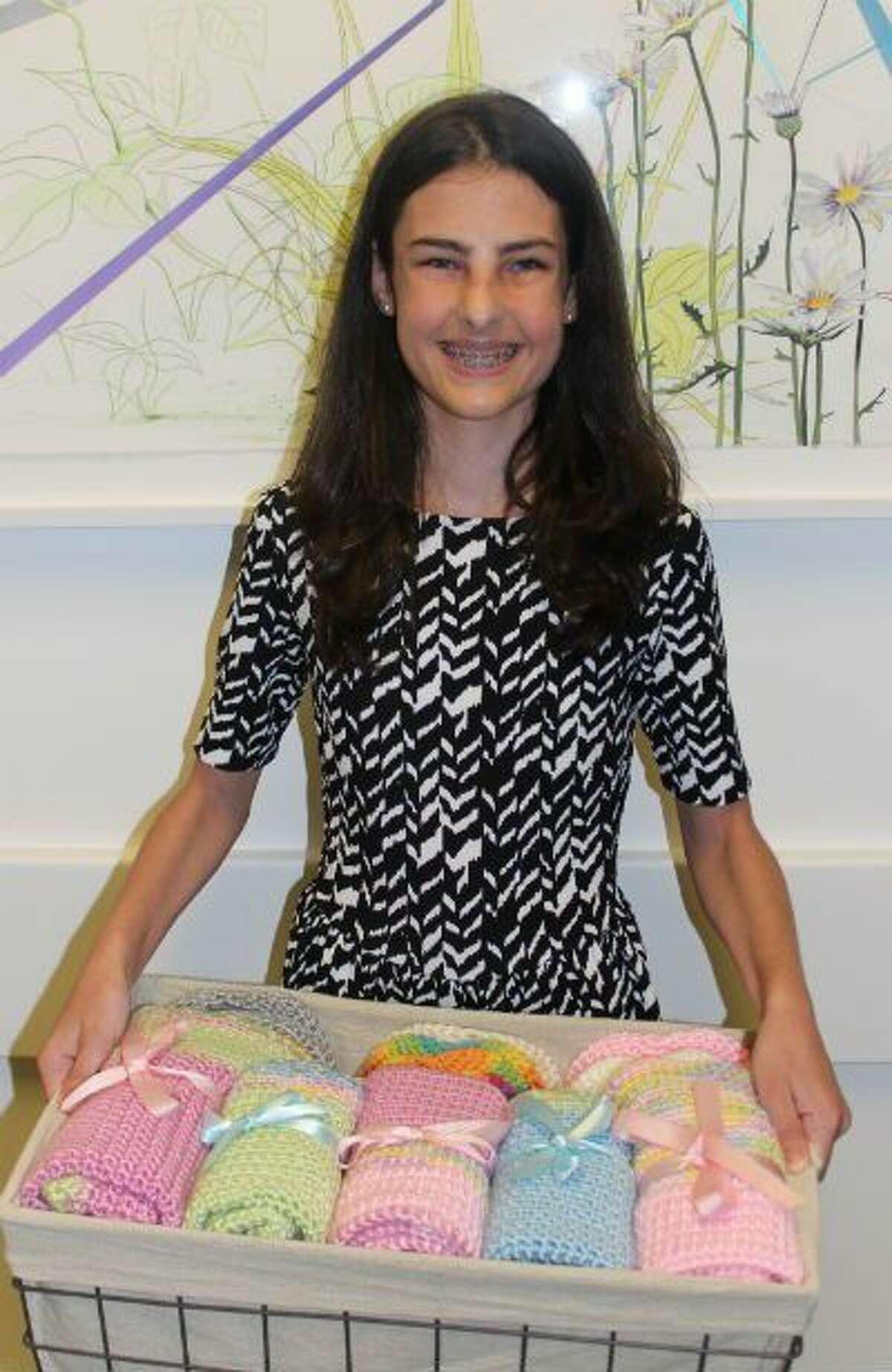 Former NICU patient Hannah Fox, 13, delivers handmade blankets to Children's Memorial Hermann Hospital.
