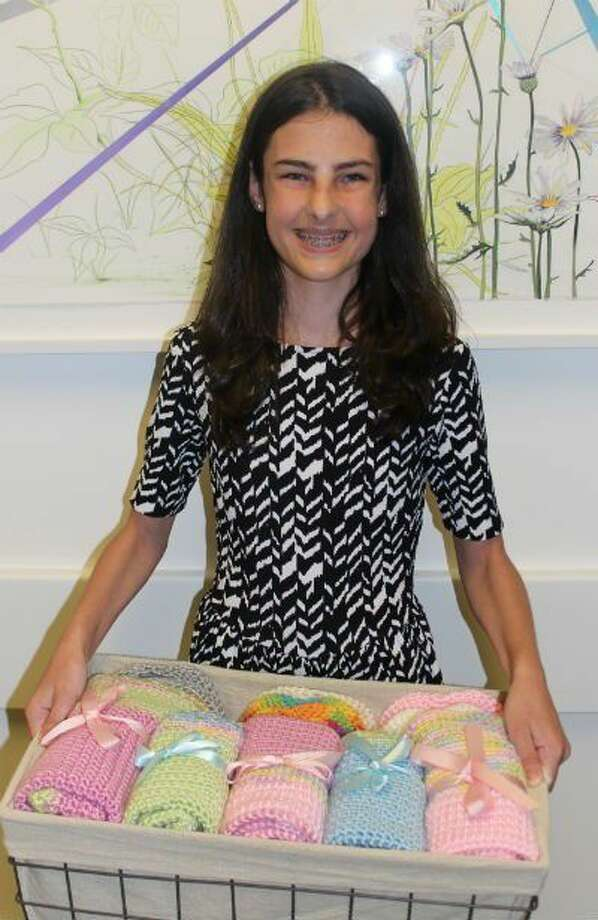 Former NICU patient Hannah Fox, 13, delivers handmade blankets to Children's Memorial Hermann Hospital. Photo: Submitted Photo
