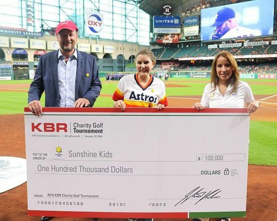 Pictured from left are Stuart Bradie, President and CEO of KBR, Inc.; Sunshine Kid Sophia Sereni; and Rita Suchma, Director of Development for the Sunshine Kids Foundation. Photo: Submitted Photo
