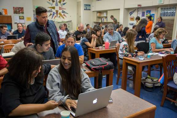 From left: Sue Datta and her daughter Sonia Mahajan, age 16, during a FAFSA workshop at Carlmont High School, on Thursday, Oct. 6, 2016 in Belmont, Calif. Students can now file the application for student aid as early as October 1 and the application will use the income numbers from two years ago, instead of the previous year.