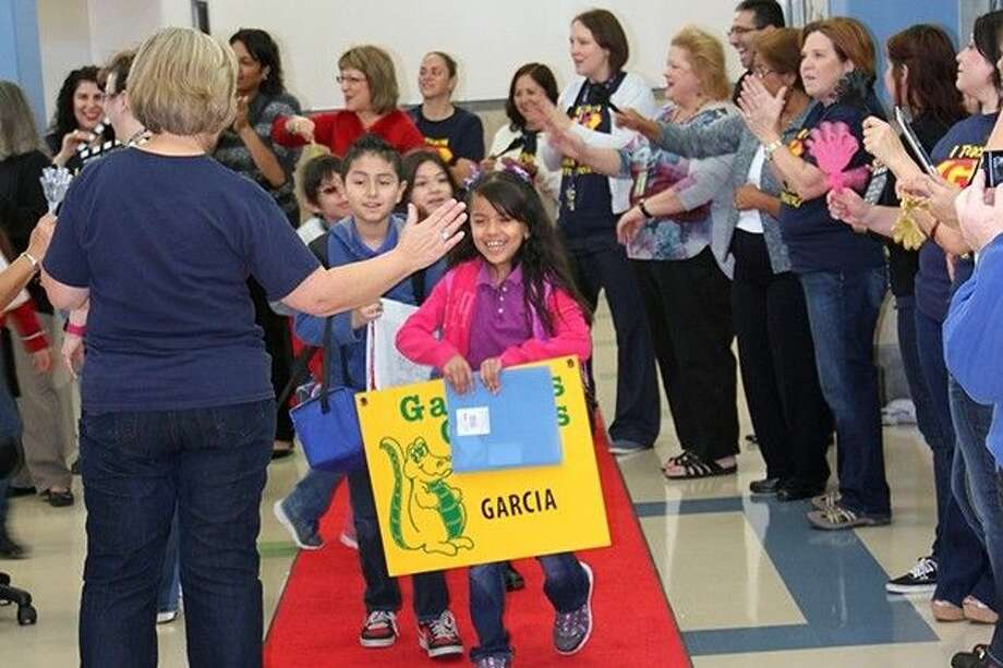 Gardens Elementary students and staff roll out the red carpet as they celebrate the new campus.