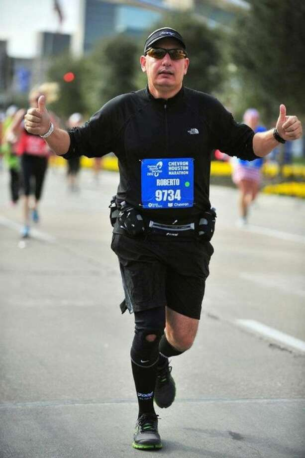 Corporate Chef Roberto Ozaeta crossing the finish line at the 2012 Chevron Houston Marathon.