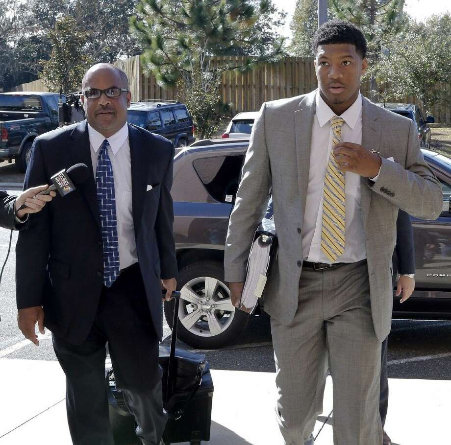 Florida State quarterback Jameis Winston, right, and his attorney David Cornwell arrive at Florida State's Materials Research building for his student code on conduct hearing. Photo: Don Juan Moore