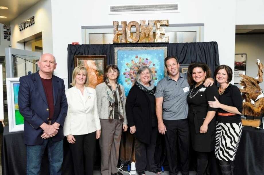 Several of the artists who are creating original works in support of Montgomery County Habitat for Humanity's 25th Anniversary Gala include (left to right): Bill Brenza, Carol Scheferman, Joella Wheeler, Sue Burke Harrington, Shae Skidmore, Shirley Scarpetta Skidmore and Kim Wallace. The artists' works, depicting their idea of what home means to them, will be auctioned off at the Gala May 10 at The Woodlands Waterway Marriott.