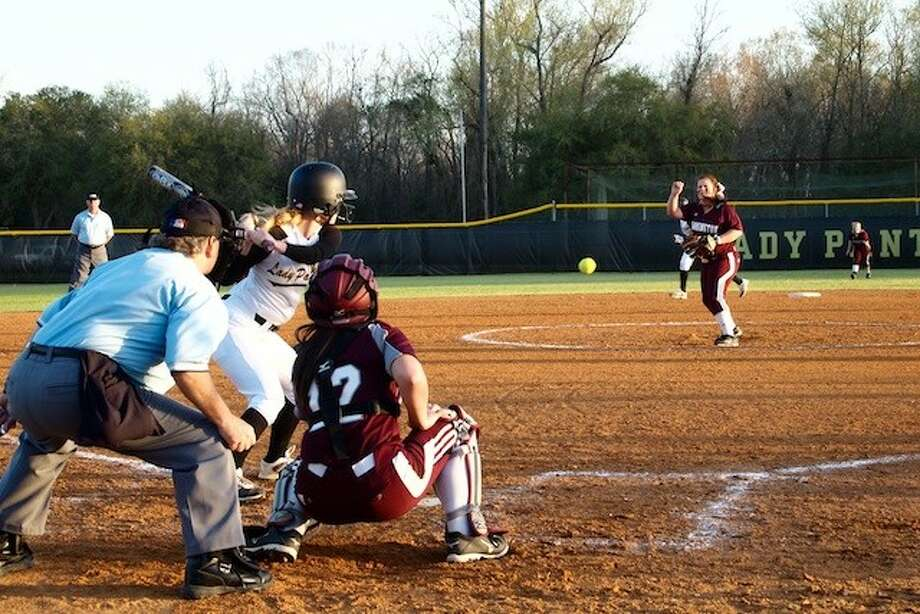 Megan Hogan pitched the early innings for Tarkington Tuesday, March 18. Liberty's Caroline Moorman is at bat with LadyHorn Baylee Rouse catching. Photo: CASEY STINNETT / Houston Community Newspapers, 2014