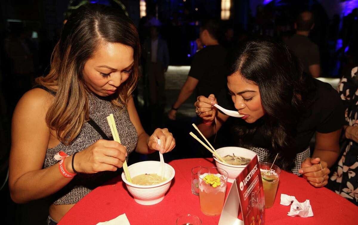 Konnie Puth, left, and Sophia Malik have pork belly ramen from Samurai Noodle at the Luckyrice Houston Feast.