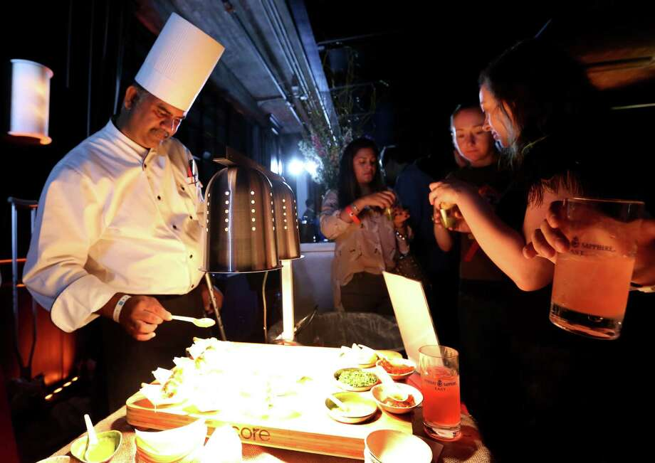 Great W'kana Cafe chef Sunil Srivastava sauces Nimbu Chuze dishes at Luckyrice Houston Feast. Photo: Yi-Chin Lee, Houston Chronicle / © 2016  Houston Chronicle