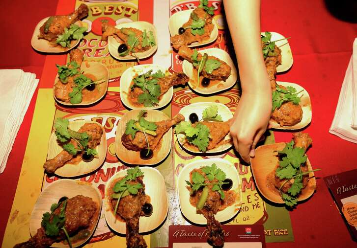 Taste of Macao brings African Chicken to the guests at Luckyrice culinary festival Thursday, Oct. 6, 2016, in Houston. It was the festival's first appearance in Houston.