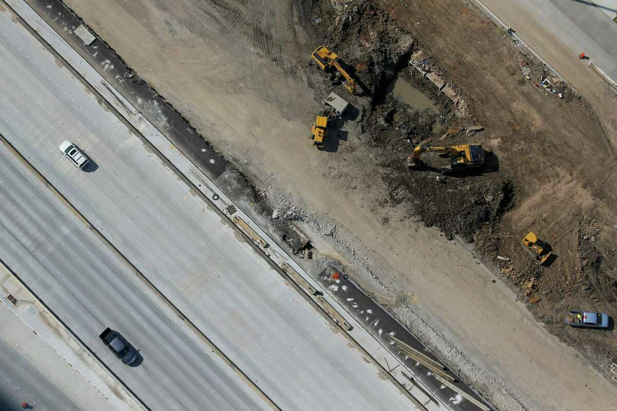 Aerial view of cars driving next to construction on Interstate 45 on Sept. 7, where crews are widening the freeway near League City.
